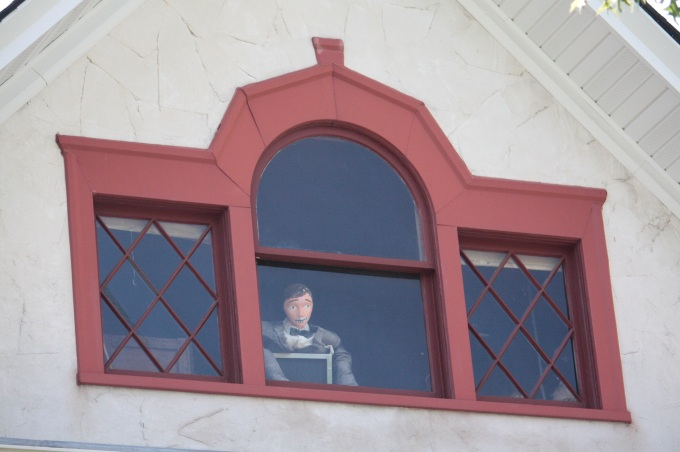 A mannequin surveys the area from the third floor of the home at the corner of James Avenue and Cleveland. Click on the image for a closer look at the mannequin's face.