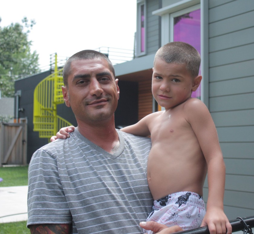 Charles Stuurop and one of his sons in their yard.