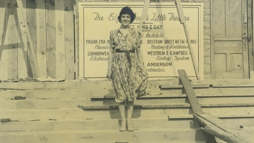Edyth Bush poses during construction in front of the theater that will bear her name.