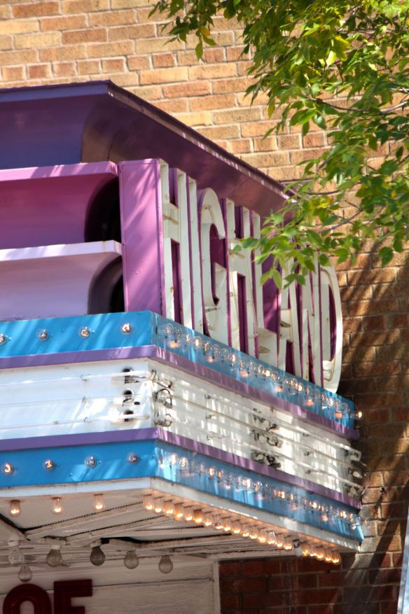 The Highland Theater marquee features some Moderne (Art Deco) cues.