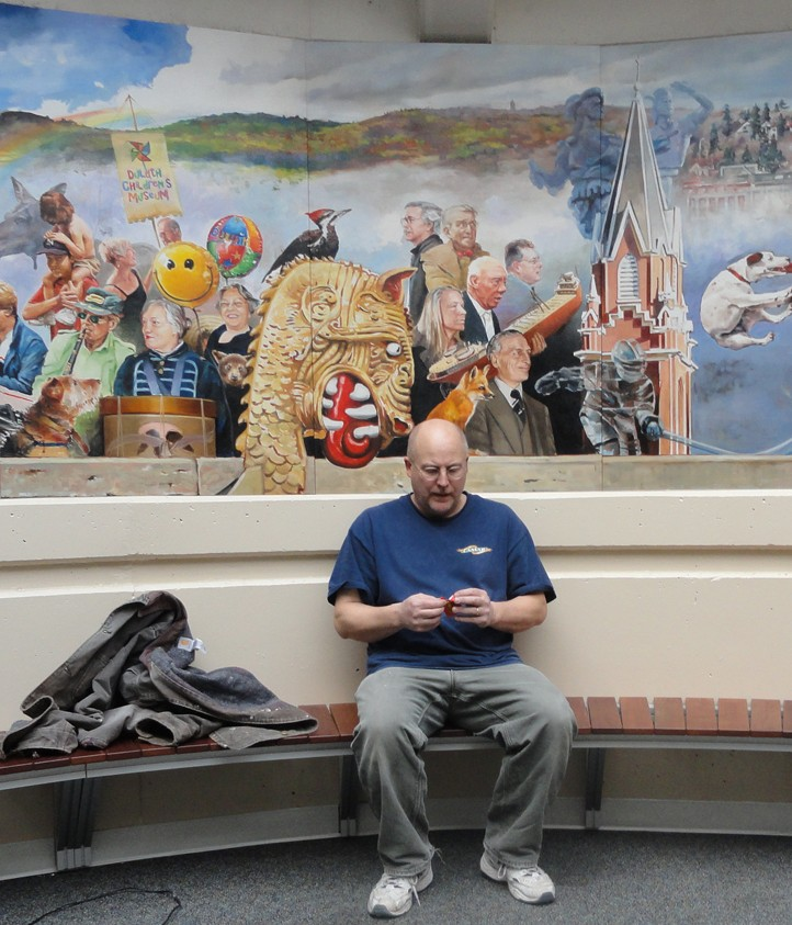 Scott Murphy in front of a mural he did in Duluth. Photo courtesy Scott Murphy
