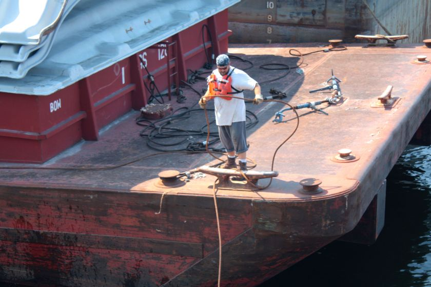 Among the docked barges were several being readied for a journey. I watched rapt as a deckhand handled steel mooring cables with the speed and dexterity that most of us move ropes.