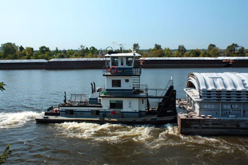 "The tug ""Mary J"" works her way upstream."
