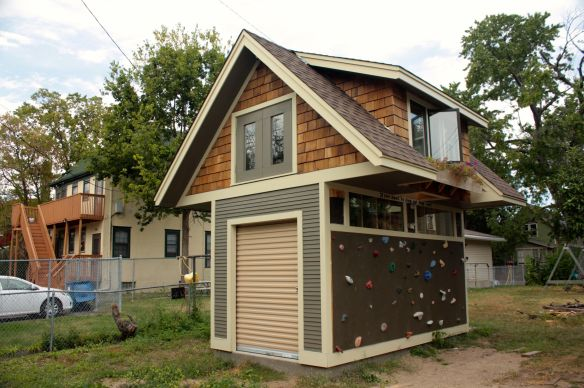 I'm guessing, but the roll up door makes me think the upper level is the children's playhouse and the lower level may be for storage.
