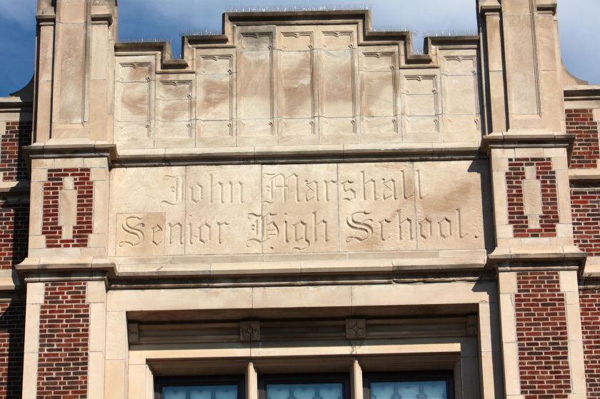 The former Marshall High School at Holly and Grotto, is also part of the Obama Elementary complex. The small antenna-like devices at the top of the building keep pigeons from roosting over the building entrance.