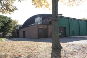 A side view of Drake Arena