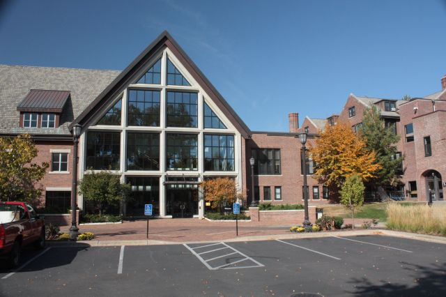 Today the modern glass and brick building is the where students enter SPA. The back of the 1910s building is on the right.