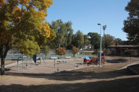 The playground, tennis courts and warming house (far right) are all popular facilities at Groveland Park Rec Center. 0856 Softball and soccer fields during warm months, this area is transformed into three lighted ice rinks during the winter.