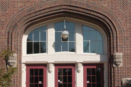 Decorative brickwork, frescos and windows surround the entrance to Groveland Park.