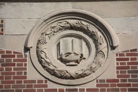 Embellishments such as the lamp of learning are common on Groveland and other school buildings of this vintage.