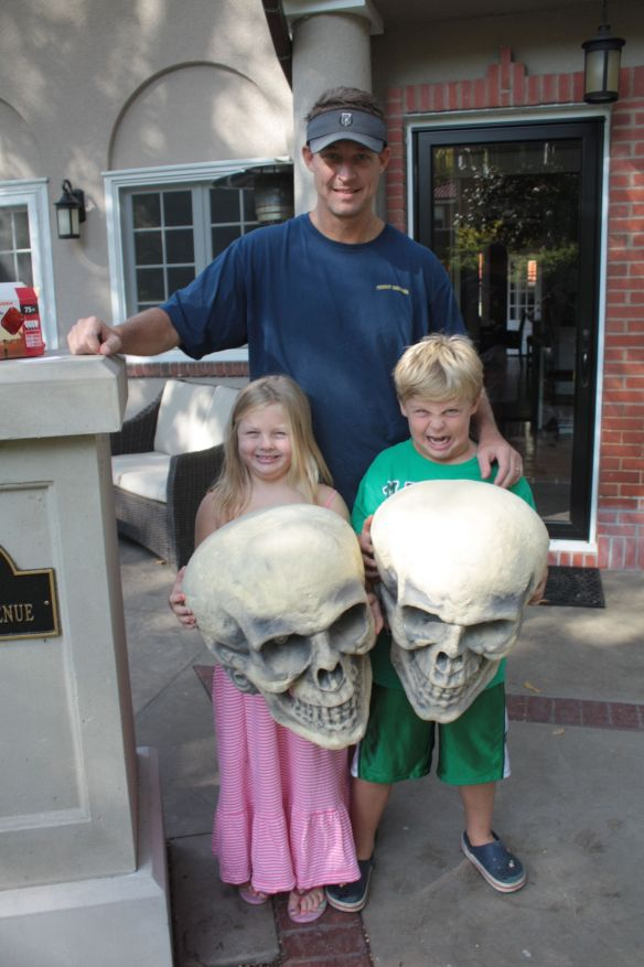 Ava Anderson, 5, and brother Max, 7, hold some serious Halloween decorations. Max told me he was growling like a zombie.