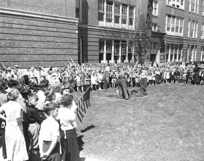 Arbor Day 1937 and children are planting a tree at Mattocks School.