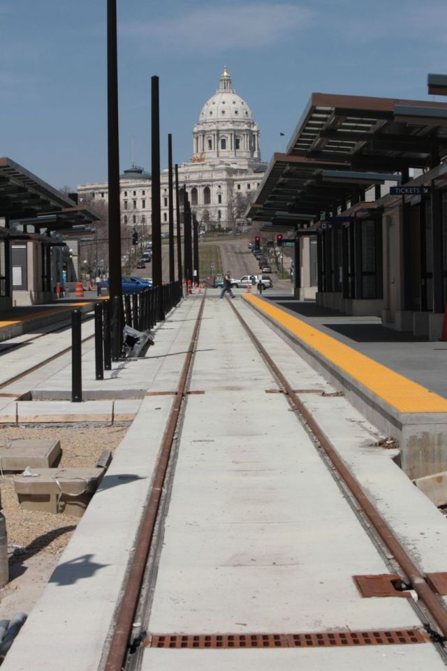 The unfinished 10th street Green Line light rail station frames the Capitol.