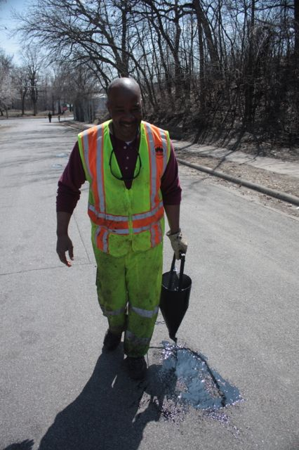 First, tar is put into the pothole.