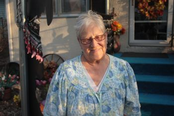 Darlene Hammond in front of her home.