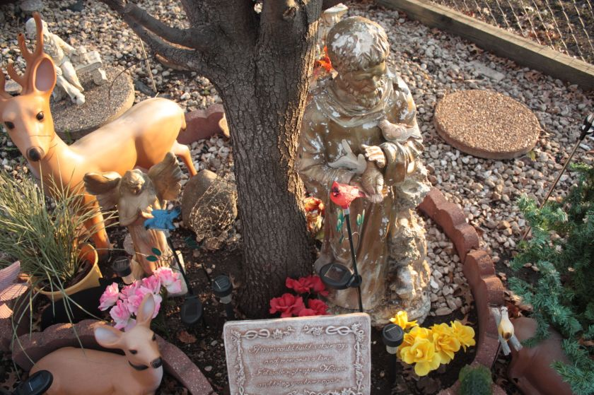 Another view of Darlene's memorial to her late children. St. Francis of Assisi, right. The pink, red and yellow flowers represent each of her children.