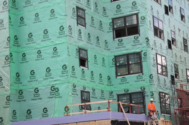 nteresting decision to go with the Green Guard Classic Wrap rather than the New Green Guard Wrap. An apartment building under construction at Grand Avenue and Finn.