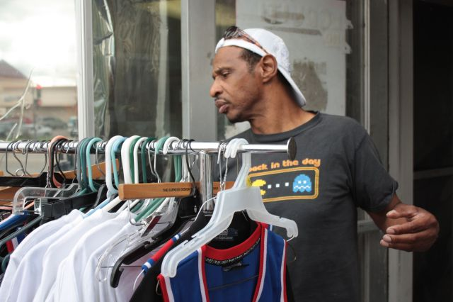 Clifford Dodd sells shirts, socks and other items from the sidewalk in front of his store on University Avenue.