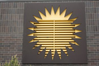 The sun logo is also prominently featured on one of the central plant's vents.