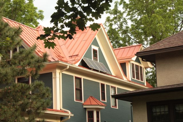 This house is more than 100 years old but has a couple of modern features on the exterior-solar panels and a metal roof.