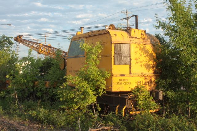 The Burro maintenance crane sits on a spur track along Capp Avenue.