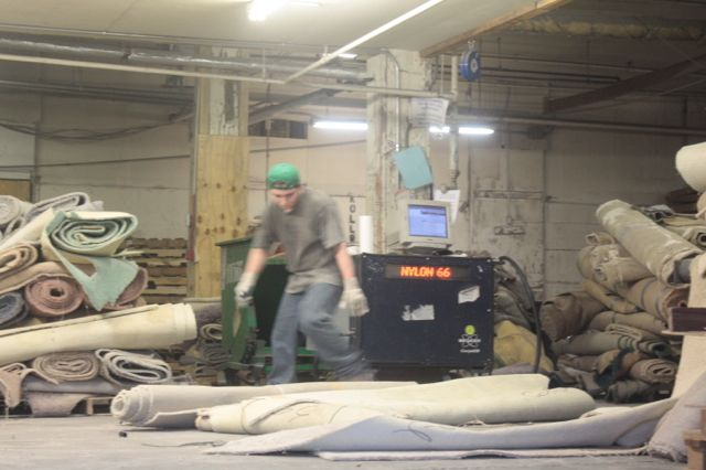 The materials from this carpet could become new carpet again, plastic resin for making plastic parts, plastic drainage pipe, new carpet pad, acoustic matting or as an energy substitute for natural gas and coal. (Apologies for the quality of the pictures. It's the result of low light in the factory.)