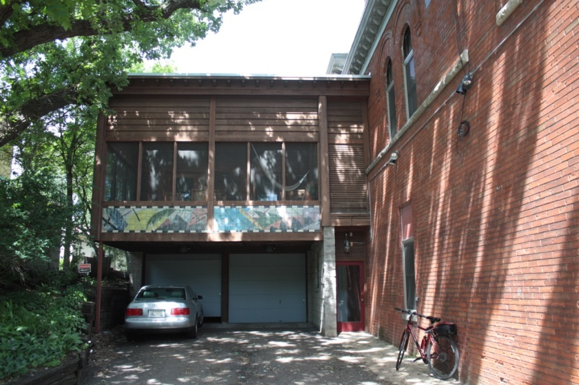 The two car garage and screened in porch were added after the fire house was purchased and converted into a home.
