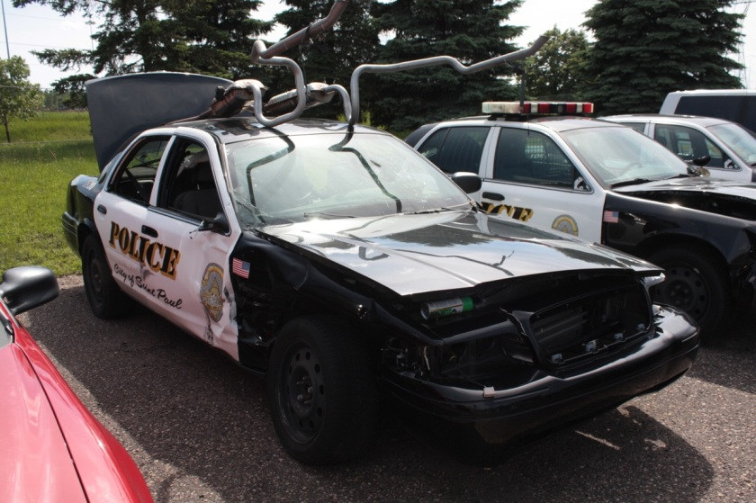 Two squad cars sit ready for repair.