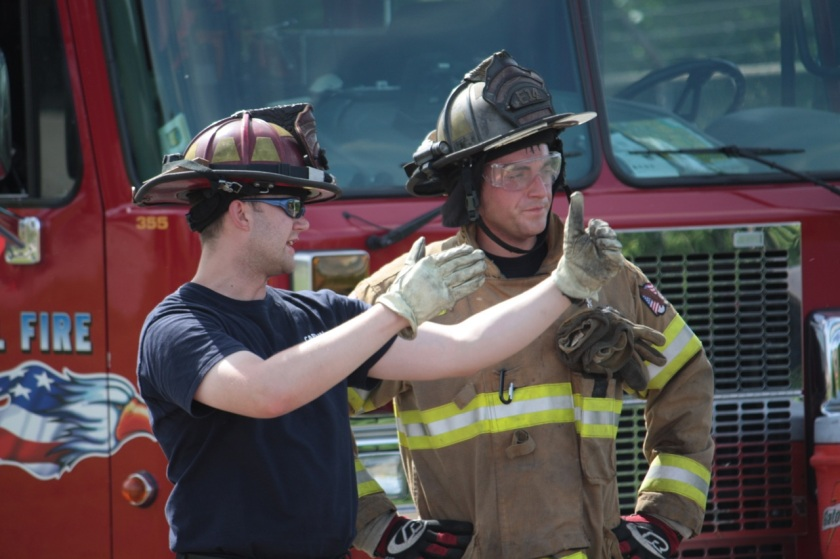 Captain Mike Aspnes and another captain discuss the training.