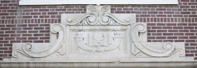 Decorations above Linwood's main entrance. The owl likely symbolizes wisdom.