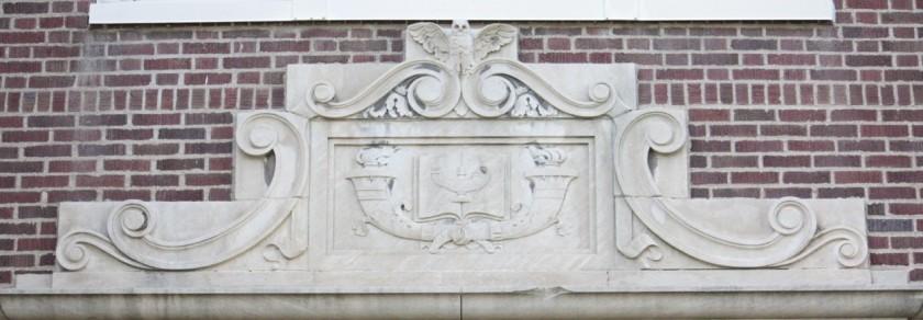 Decorations above Linwood's main entrance. The owl likely symbolizes wisdom.