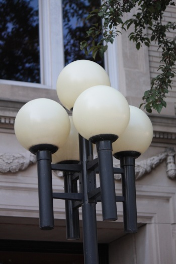 Light fixtures from the '80s clash with the classically designed building.