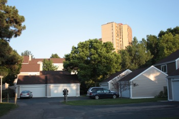 Several town homes with the senior apartment building in the background.