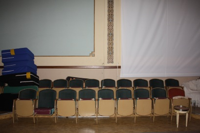 The auditorium retains the original chairs used during Masonic meetings.