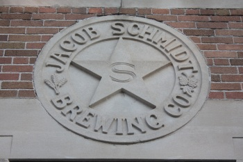 The old company seal above the former Rathskeller.