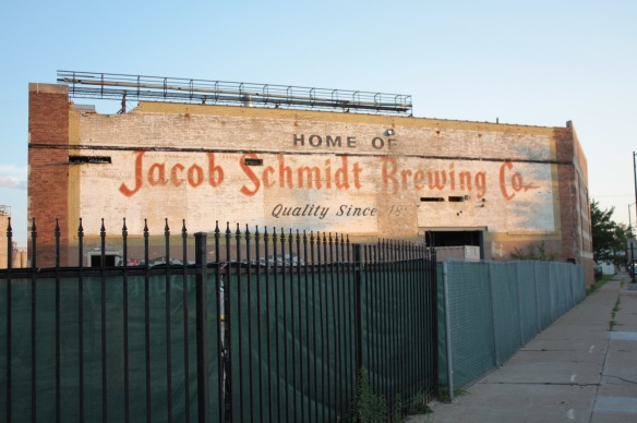 Murals decorate two sides of this building. The Schmidt sign was recently uncovered during renovations.