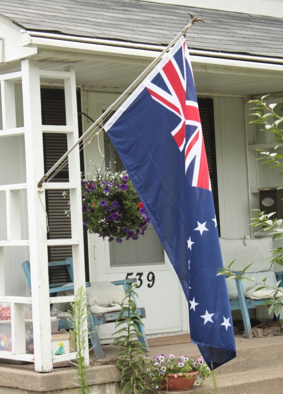 A different red, white and blue; the flag of Cook Islands at a home on Glendale Street in Desnoyer Park.
