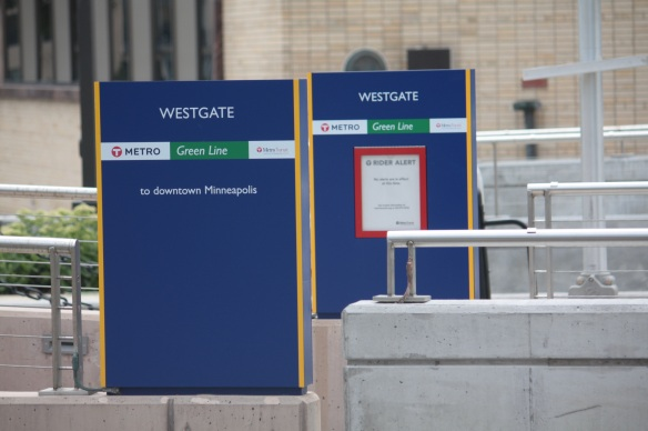 Signs for the Green Line stop at University and Emerald, in front of KSTP.