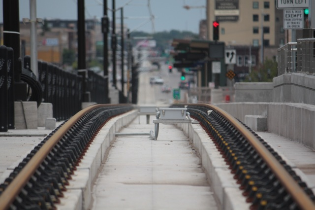 The eastbound tracks of the Green Line fade into the distance near highway 280.