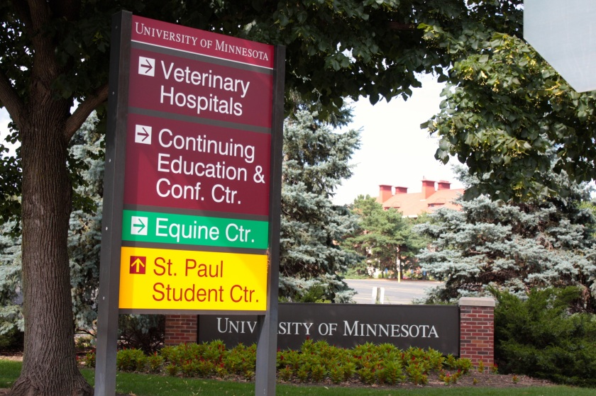 Signs for the campus along Cleveland.