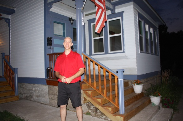 John Gladis in front of his home at 170 McBoal Street.