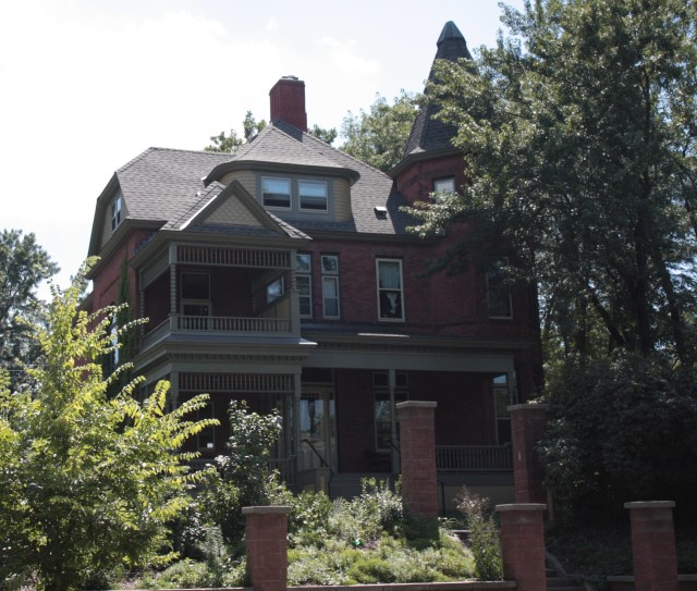 Known as the Castle, the Daniel and Elizabeth Lawler House, has a variety of distinctive features including the peaked tower on the right and two story porches on the left.