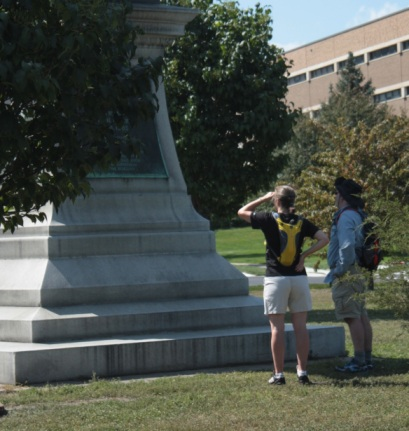 With Saint Paul College in the background, a couple reads one of the historical markers on the Soldier and Sailors Monument, a Civil War Memorial on open space along John Ireland Boulevard.