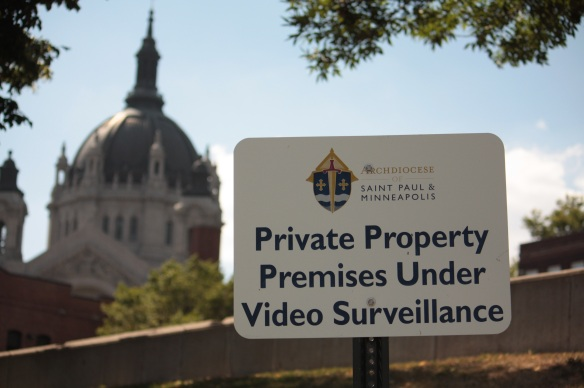 These signs surround the Hayden Center and parking lot. The Saint Paul Cathedral is in the background.