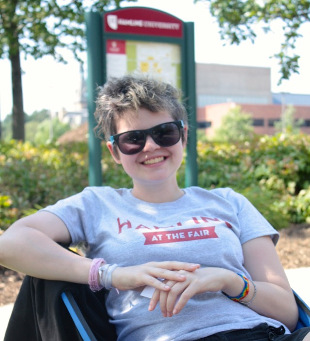 Hamline University junior Tori Liston relaxes as she oversees the school's parking lot on Pascal Street.