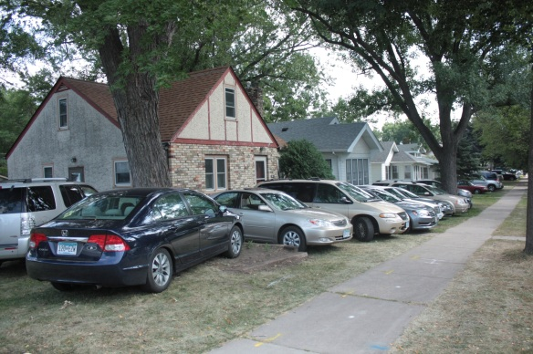 Parking on the front lawns of houses in the 1400 block of Snelling.)