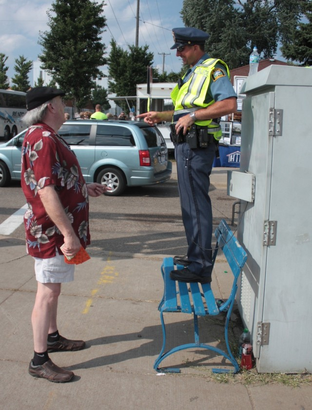Another police officer manually controls the stoplights at Snelling. He also visits with passers by.