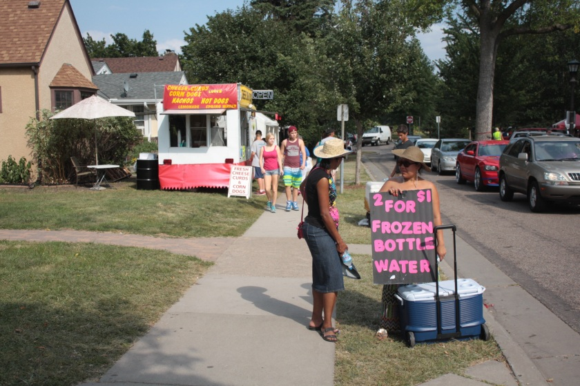 Front lawns aren't used solely for parking. Street vendors who can't or choose not to locate on the Fair grounds ply their wares on Midway Parkway.