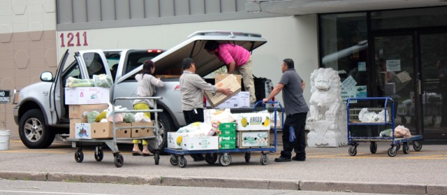 Customers load up on a variety of produce at Star Ocean Foods.