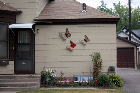 Giant monarch butterflies on the house at 906 Stinson Street